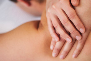 hands giving remedial massage to shoulder