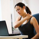 woman feeling neck and shoulder pain due to stress